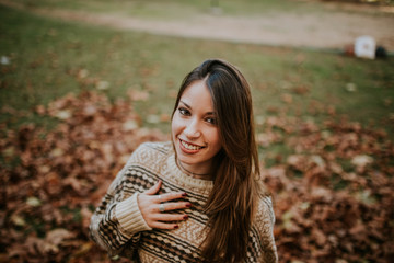 Smiling female in autumn lawn