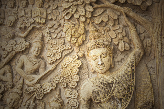 Low-relief image of beautiful woman in the north of temple of Thailand, no copyright