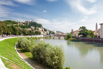 Sunny view of Adige river and Stone Bridge (Ponte di Pietra) in Verona, Veneto region, Italy.