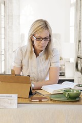 Blonde woman working at desk