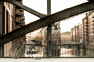 bicycle parked on a bridge in old warehouse district Speicherstadt in Hamburg, Germany