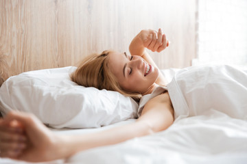 Side view of woman waking up after sleep