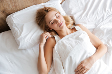 Top view of woman lying with closed eyes