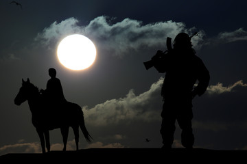 silhouette of military man on a horse on sunset background