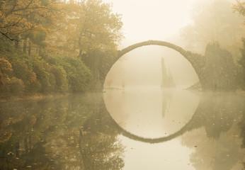 Rakotz bridge in Kromlau (Devil's bridge) in early morning mist