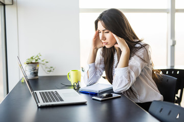 Young lady with tired in modern office.