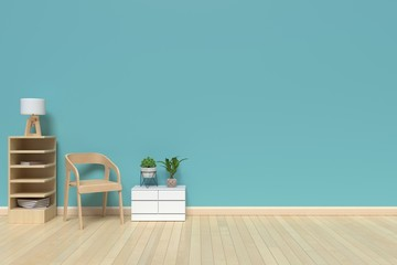 The interior has a gray sofa and lamp on empty blue wall background,3D rendering