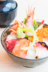 Japanese rice bowl with sashimi seafood on top