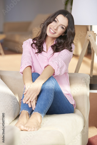 chilling out at home shot of a beautiful happy young woman relaxing on sofa at home. Black Bedroom Furniture Sets. Home Design Ideas