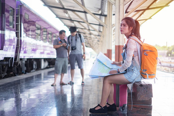 Beautiful young tourist in train station