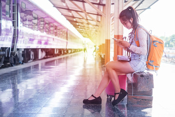 Euphoric woman watching her smart phone in a train station