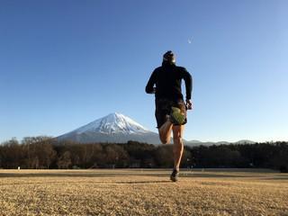 Man running towards snow capped Mt Fuji