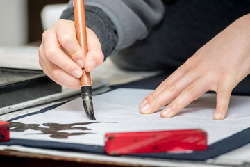 """Focusing on the spirit, writing Japanese artistic characters with a brush Japanese traditional culture is called """"syodo"""""""