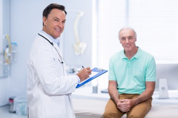 Portrait of smiling doctor and senior patient