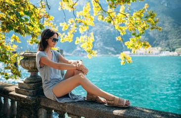 Young woman relaxing on beautiful Garda lake Wall mural