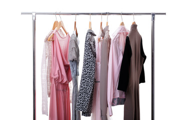 gray, pink womens clothes on hangers on rack on white background
