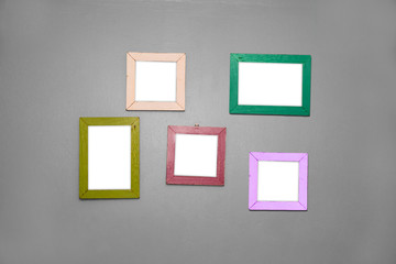 5 Empty vintage frame isolated on gray cement wall.