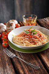 spaghetti with tomato sauce with parmesan cheese and basil