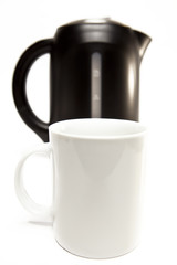 electric tea kettle on a white background and a mug