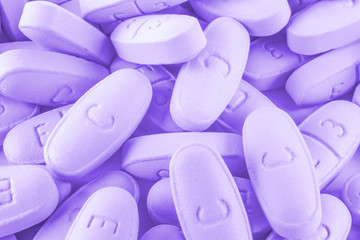 Purple pills as background