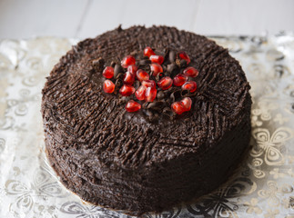 Chocolate cake decorated with pomegranate seeds