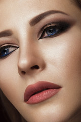 Beautiful brunette girl with arabic evening make-up and perfect skin. Beauty face. Close up.