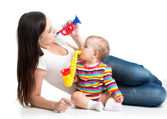 Mother and baby having fun with musical toys. Isolated on white background