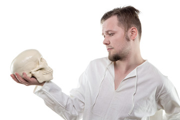 Thinking man with human skull
