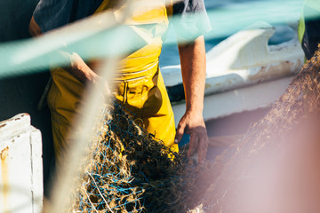 Man working with fishing net