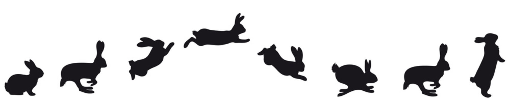 jumping Silhouettes of Easter bunnies black