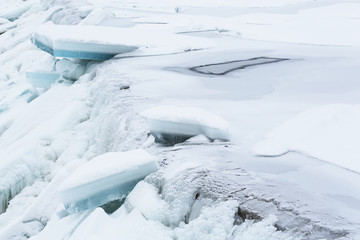 Ice blocks falling down a waterfall in the winter