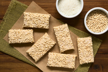 Baked marshmallow, popped quinoa and coconut bars with ingredients on the side, photographed overhead with natural light