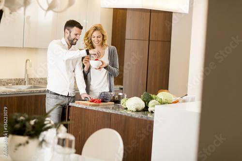 Loving couple prepating vegetarian food in the modern - The modern vegetarian kitchen ...