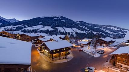 alpine village in winter twilight
