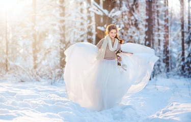 Beautiful bride in snowy winter forest