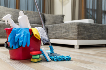Cleaning service. Bucket with sponges, chemicals bottles and mopping stick. Rubber gloves and towel. Household equipment.