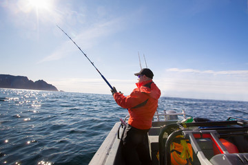 Fisherman catches athlete middle of the sea with boats