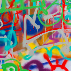 Beautiful street art graffiti closeup. Abstract creative drawing fashion colors on the wall of the city. Urban modern culture