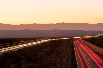 Nighttime traffic on Interstate I-10 through the desert in California
