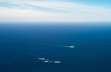 Small ship passing a reef at West Cape, Stad,  Norway