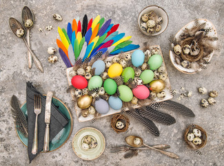 Easter table decoration eggs feathers vintage cutlery flat lay