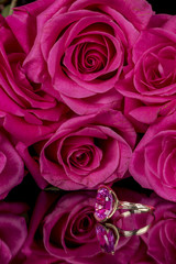 Pink roses and a ring of the same color