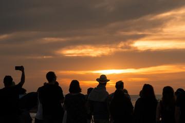 Silhouette Of People Watching Sunset On Ocean