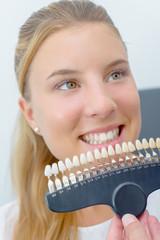 Young woman choosing dentures