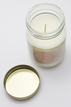 White Candle in a Glass Jar