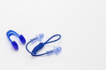 Nose clip and ear plugs for swimming pool on white background