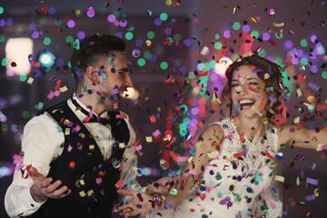 Fototapeta Cute happy wedding couple against defocused lights obraz