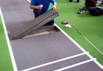 Long jump board being placed in the runway