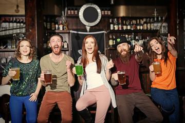 People celebrating Saint Patrick's Day in pub