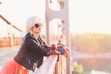 Beautiful blond woman posing on the bridge